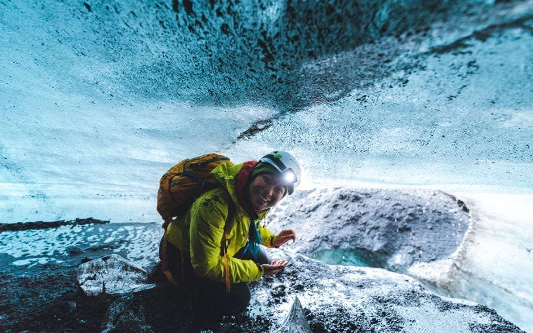 One of our tour guides getting up close to some blue ice